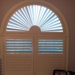 Bath Shutters with Sunset arch over tub - Columbia Blinds and Shutters