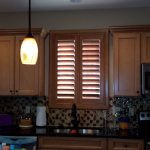 Kitchen Sink Stained Norman Shutter - Columbia Blinds and Shutters