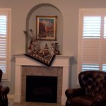 Living Area Norman Shutters frame Fireplace - Columbia Blinds and Shutters