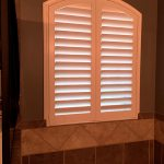 Louvered Arch Shutter over master bath in Old Hawthorn - Columbia Blinds and Shutters