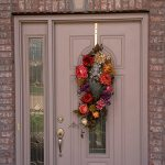 Norman shutter over entry door (2) - Specialty Window Coverings - Columbia Blinds and Shutters