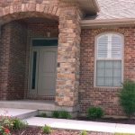Shallow arch shutters exterior view - Columbia Blinds and Shutters