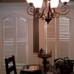 Shallow arch shutters windows in dinning room Interior view - Columbia Blinds and Shutters