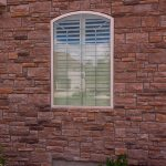 Shallow arched Normandy shutters (2) - Columbia Blinds and Shutters