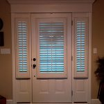 Side lights and Entry door covered with shutters (2) - Columbia Blinds and Shutters