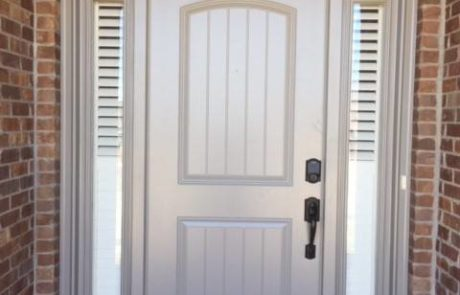 Norman Shutters on Door Sidelights Windows for Front Doors by Columbia Blinds and Shutters in Missouri